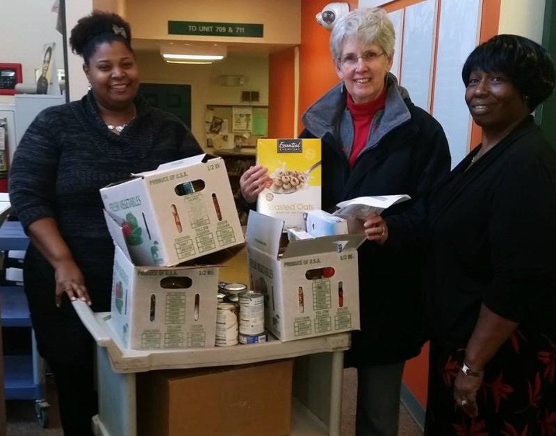 mill creek members with food boxes